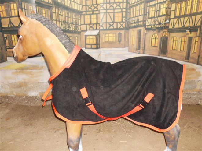 Red and black fleece foal rug